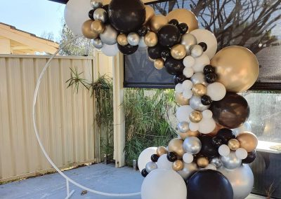 Round Backdrop Hire with Gold Balloon Garland